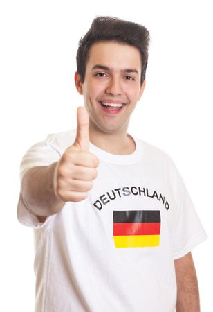 German sports fan with black hair showing thumb up photo