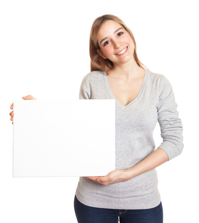 Attractive woman presents a blank board photo