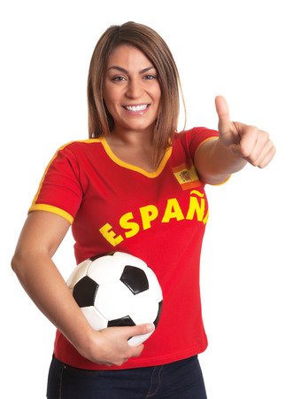 Spanish girl with football showing thumb up  Stock Photo