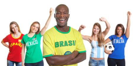 Laughing man from Brazil with four female sports fans photo