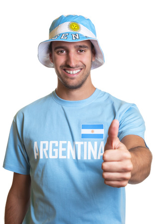 Attractive guy with argentinian jersey and hat showing thumb up photo