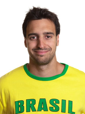Portrait of an attractive guy with brazilian jersey photo