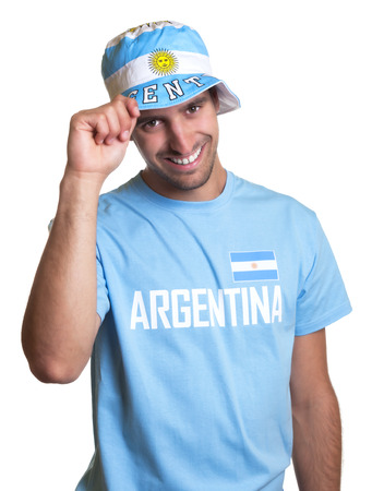 Attractive guy with argentinian jersey and hat laughing at camera photo