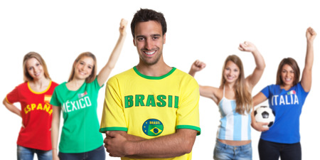 Attractive man from Brazil with four female sports fans photo