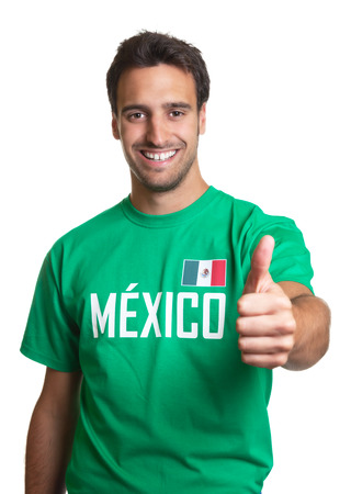 mexican flag: Laughing guy in a mexican jersey showing thumb up