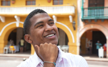 afro caribbeans: Lauhing guy in a colonial town