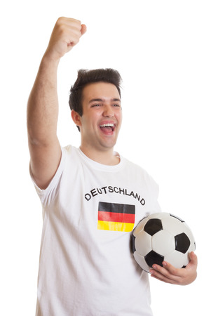 Screaming german soccer fan with football photo