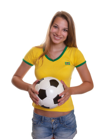 Standing woman in brazilian shirt with football photo