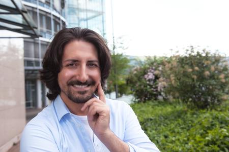 turkish man: Turkish man with beard outdoors laughing at camera