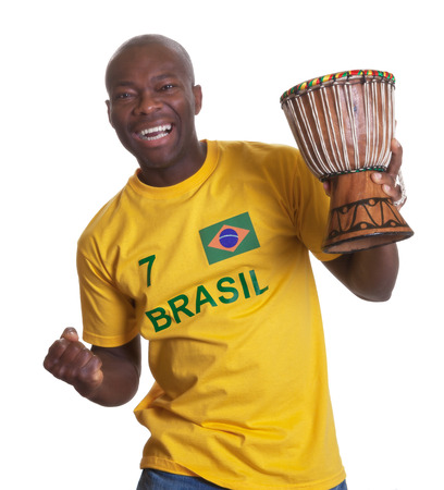 Guy from Brazil with drum is happy about his team photo