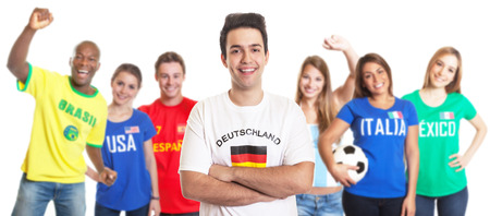 Laughing sports fan from Germany with fans from other countries photo