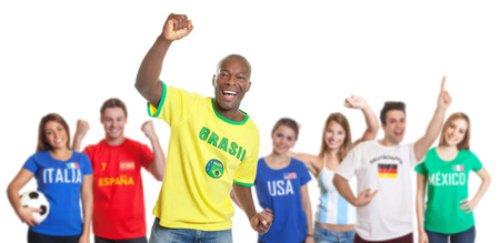 Goal celebration of a brazilian soccer fan with fans from other countries photo