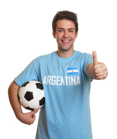 Argentinian soccer fan with ball showing thumb up 版權商用圖片