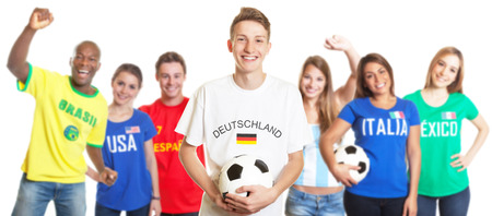 Laughing german soccer with blond hair with fans from other countries photo