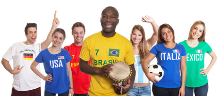 Brazilian football fan with drum and fans from other countries photo