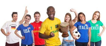 Cheering brazilian football fan with drum and other fans photo