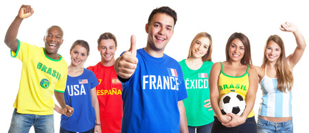 French soccer fan showing thumb up with other fans photo