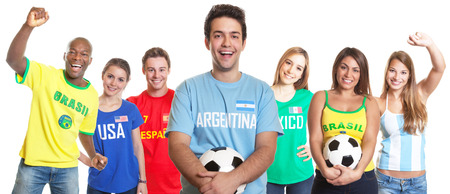 Argentinian soccer fan with ball and other fans photo