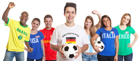 German soccer fan with ball and other fans photo