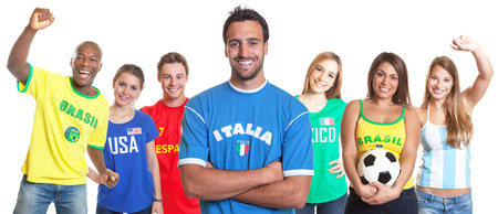 Italian soccer fan with crossed arms and other fans photo
