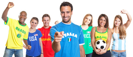champion spain: Italian football fan pointing at camera with other fans