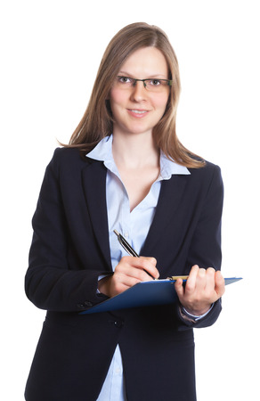 Laughing businesswoman with glasses making notes photo