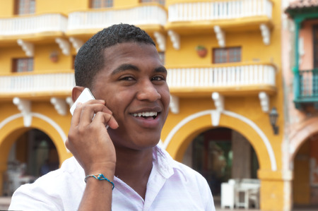 Attractive guy talking at phone in a colonial town photo