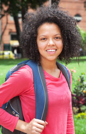 mexican black: Female student with curly hair looking at camera