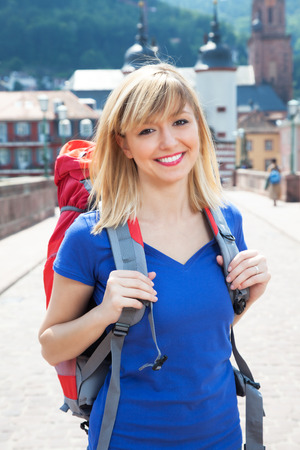 travel bag: Laughing young Backpacker in Europe