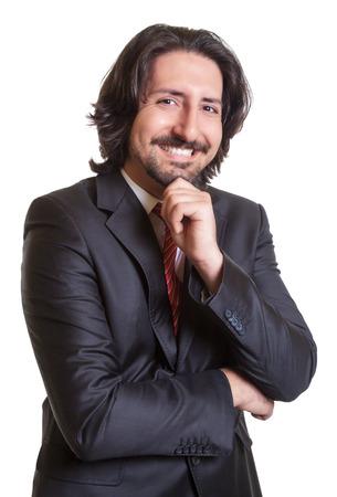 Friendly turkish businessman looking at camera photo