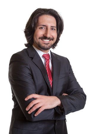 Standing turkish businessman with crossed arms photo