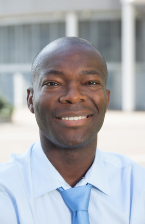 Portrait of a businessman from Africa in front of his office  photo
