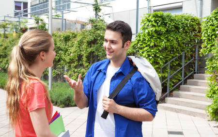 Two students talking on campus photo