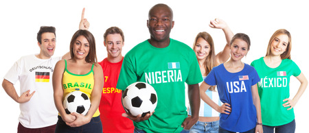 Laughing soccer fan from Nigeria with ball and other fans photo