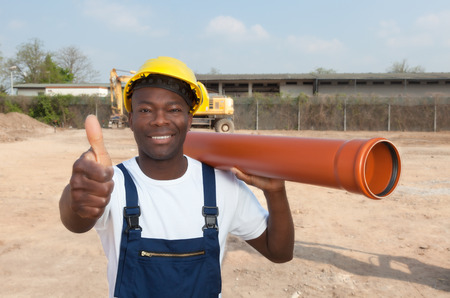 African construction worker with pipe showing thumb