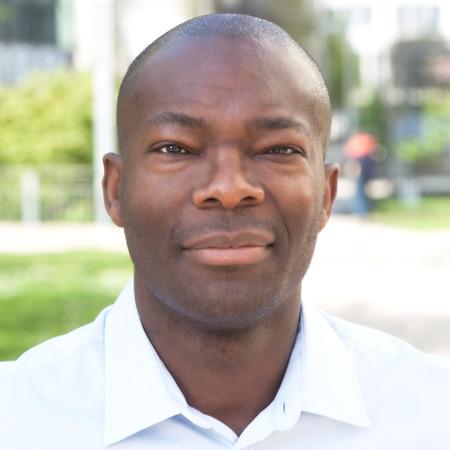 men face: Portrait of a smiling african man