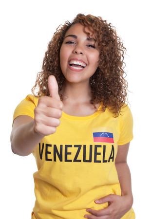 Young woman from Venezuela showing thumb photo