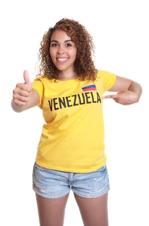 Young woman from Venezuela pointing at shirt photo