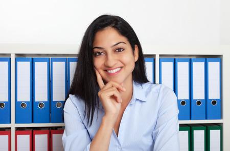 Turkish businesswoman laughing at camera