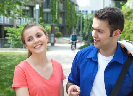 Two students talking about education photo