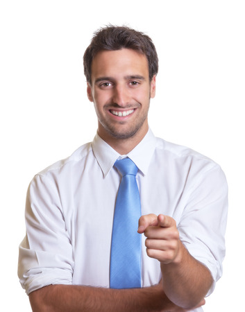 Pointing latin businessman with blue tie photo