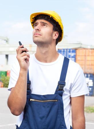 docker: Docker with walkie talkie at work