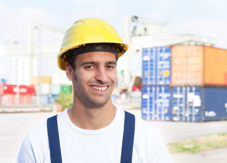 docker: Docker laughing at camera on a seaport Stock Photo