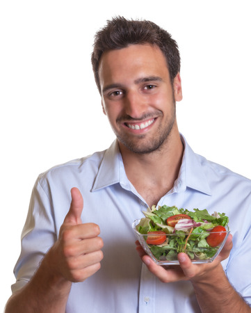 colombian food: Latin man recommending fresh salad  Stock Photo