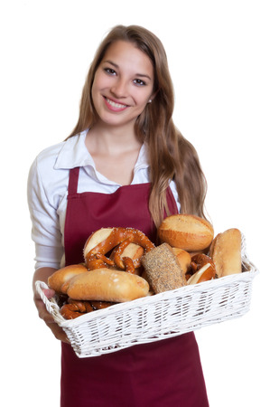 bakery oven: Laughing woman with bread rolls from the bakery
