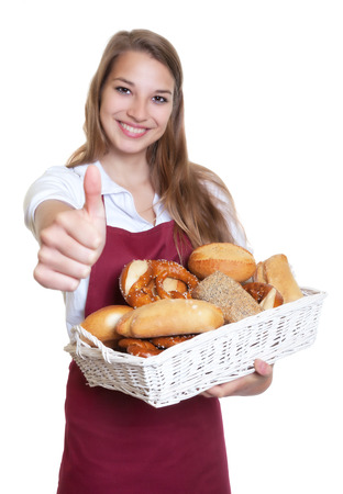 Saleswoman of the bakery showing thumb up
