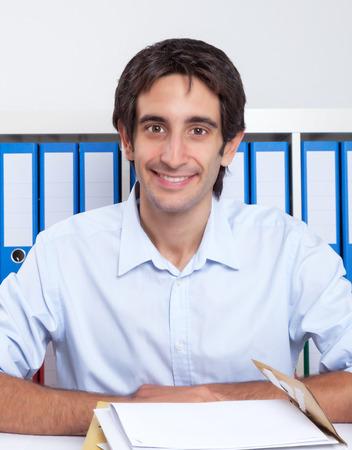 Spanish guy working at desk photo