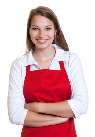 salesgirl: Waitress with red apron and crossed arms Stock Photo