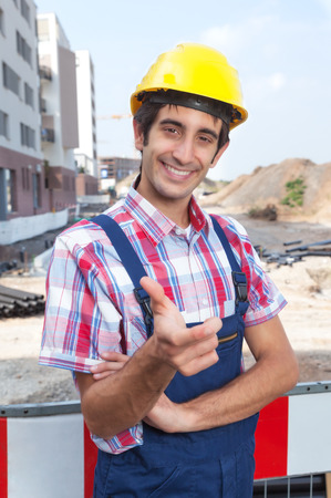 dug well: Happy construction worker with black hair