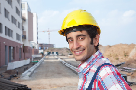 dug well: Laughing construction worker with black hair